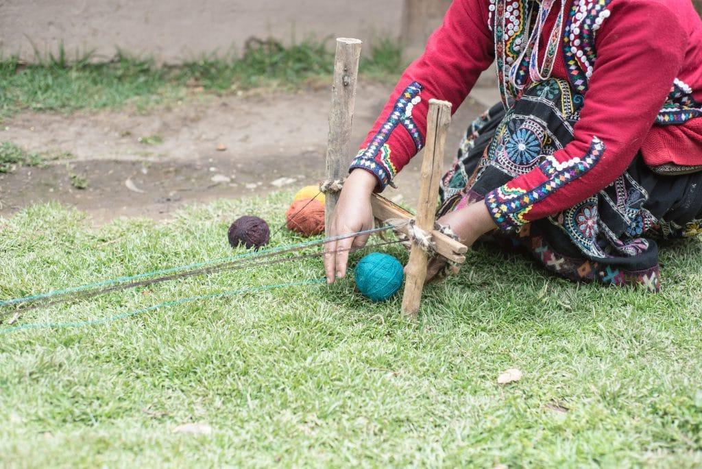 Peruvian Weaving - Women establish the framework for their scarf