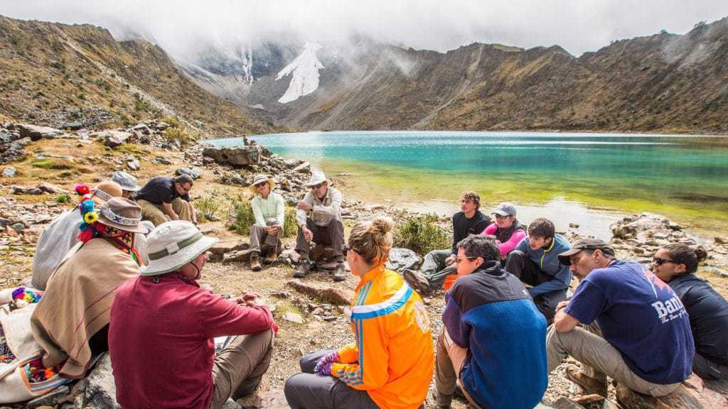 Trekking group relaxing on the Salkantay Trek to Machu Picchu