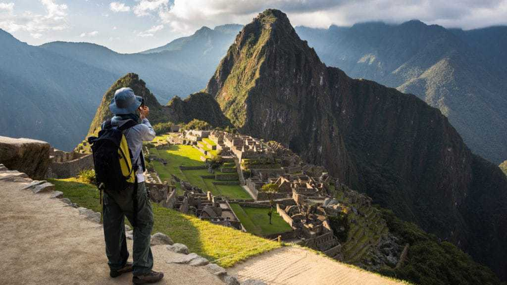 Hiker at Machu Picchu following Inca Jungle Trail