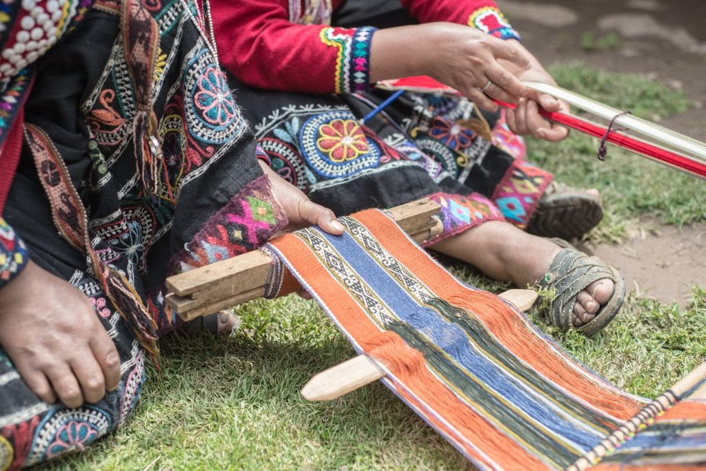 Peruvian Textiles - Women weaving a scarf
