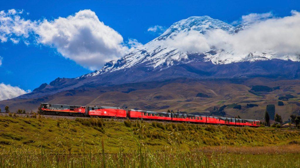 Ecuador Cruise Train, Tren Crucero, passes a snow-capped volcano