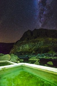 Colca Canyon trek - Llahuar Lodge pools by night.